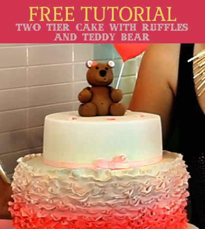 two tier cake with ruffles and teddy bear