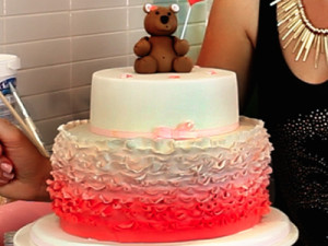Two Tier cake with Ruffles and a Teddy Bear