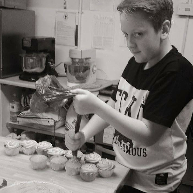 Rose Macefields baby boy making cupcakes