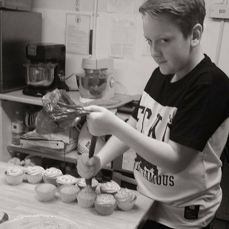 Rose Macefields baby boy making cupcakes